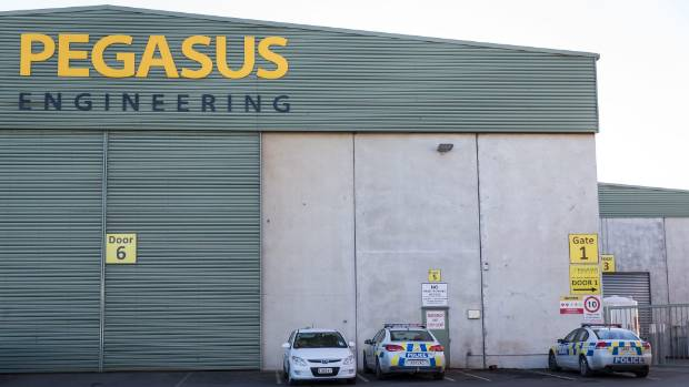 Police and WorkSafe vehicles at Pegasus Engineering on Friday, where a 59-year-old man died.