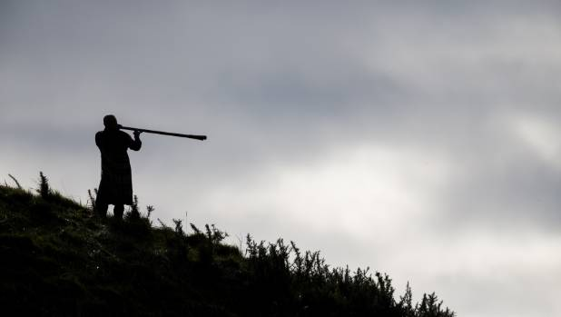 People were seen atop a hill at Parihaka with instruments during the powhiri.