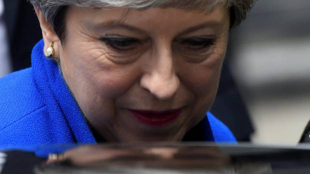 Clinging to job, May appoints ministers