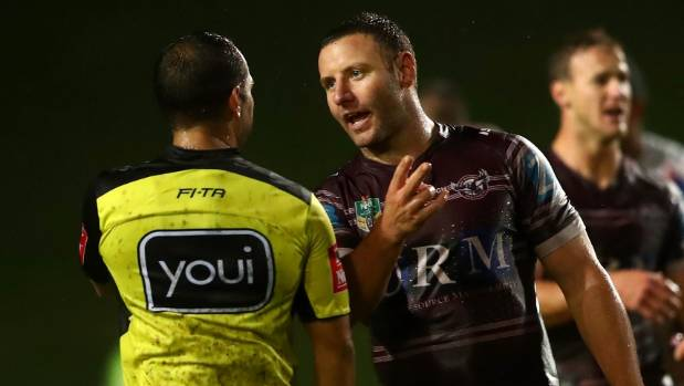 Manly's Blake Green chats with referee Ashley Klein during the Sea Eagles' controversial win over the Newcastle Knights.