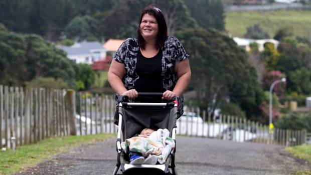 Emma Wilson is banking her time by looking after Zeke Rogers, who is fast asleep in his pushchair.