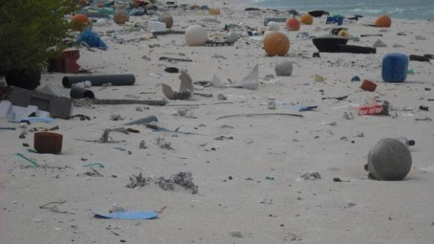 East Beach on Henderson Island covered with plastic washed up from the sea.
