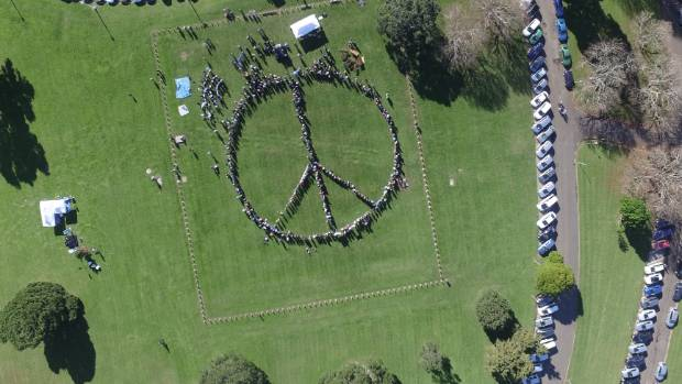A peace symbol was formed on Sunday at the Auckland Domain to celebrate 30 years of a nuclear-free New Zealand.