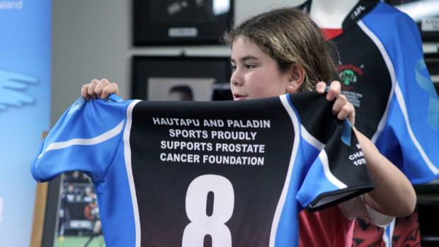 Saorise Herewini holds one of the specially designed Hautapu rugby jerseys put up for auction.