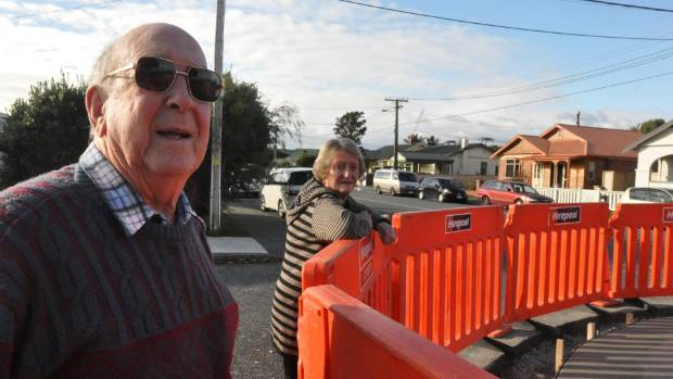 Brian Hill and Barbara Burnett survey works at one the new Tennyson St roundabouts.