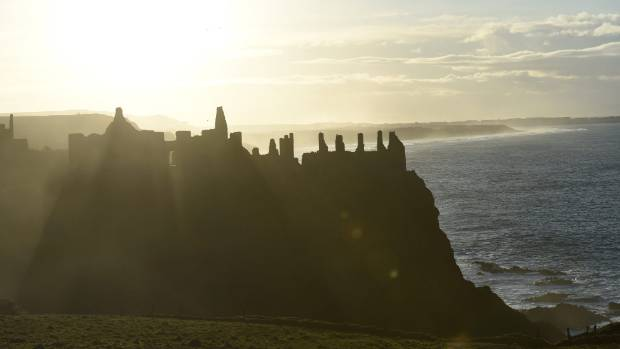 Sunset over Dunluce Castle in Portrush, Northern Ireland.
