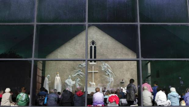 Parishioners and visitors attend mass at a Roman Catholic Church in the village of Knock, County Mayo.