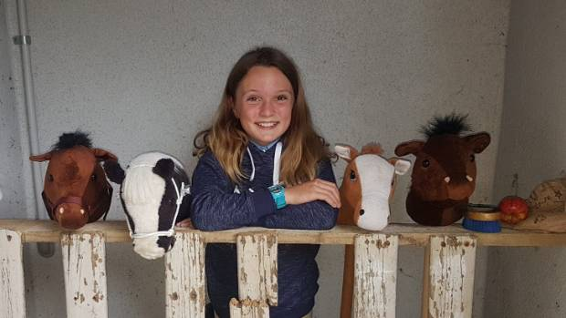 Emma Wilton, 11, with her 'stable' of hobbyhorses.