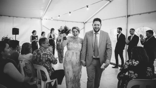 Walking up the aisle.