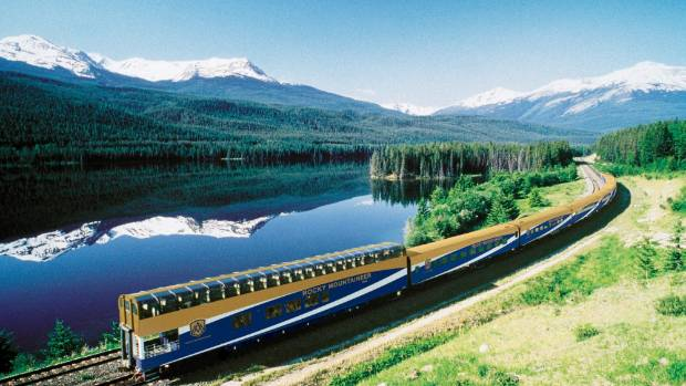 The Rocky Mountaineer rolls past Yellowhead Lake, Alberta.