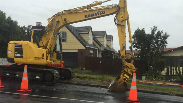 Te Atatu residents and business owners have complained there haven't been enough staff to complete the roadworks in time.