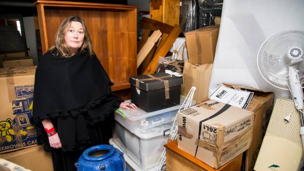 Christine Davis had to pull all her possessions out of a Kiwi Self Storage unit after it was discovered to be mouldy and ...