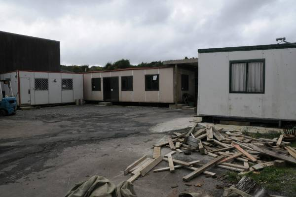 The site also features three portacom units with bedding, toilets and a kitchen shared between them.