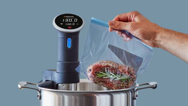 The Anova Precision Cooker cooks sous vide style while attached to your own pot.