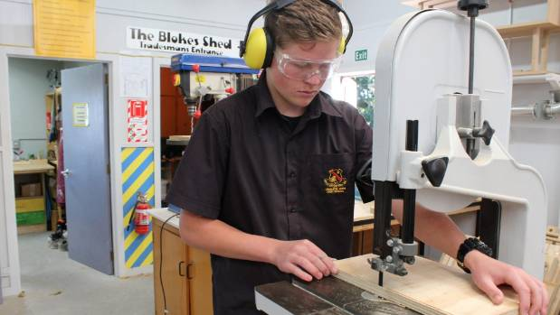 All concentration from Connor Hodgson, as he cuts a tricky pattern on the band saw.