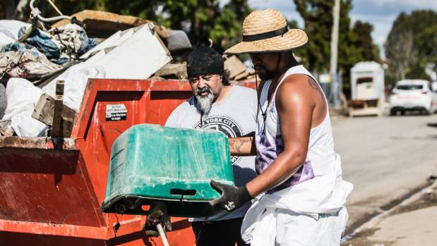 Residents and volunteers clean up Edgecumbe after a devastating flood in April