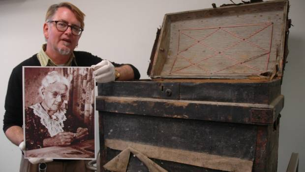 Upper Hutt City Library historian Reid Perkins with the late-1800s travel chest and a photo of Mary McCurdy, a Revelle ...
