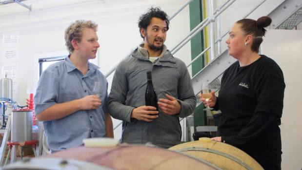 First year students, from left, Andrew Pearce, Matt White and Eliza Dozell discuss the blends they have created.