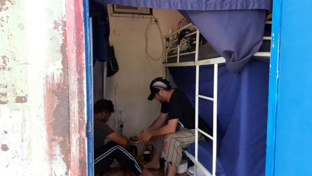 Detainees sit inside accommodation at the Manus Island detention centre in Papua New Guinea, February 11, 2017.