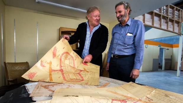 John Farquhar, left, descendant of surveyor Hugh Farquhar, looks at old survey maps with Peter Shelton.