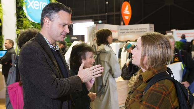 Green Party co-leader James Shaw talks to organic dairy farmer Gina Williams at the Fieldays in Hamilton.