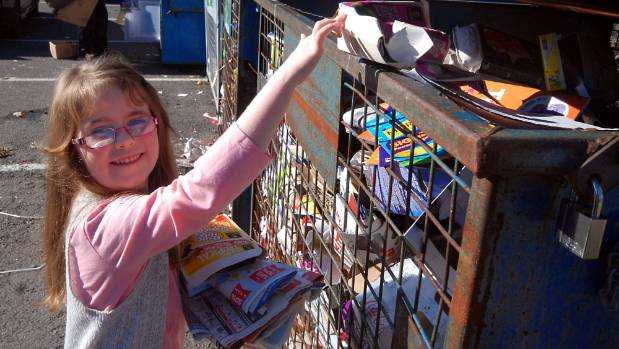 Recycling them young. Evadine Smith gets into the swing of things at the Upper Hutt drop-off station.