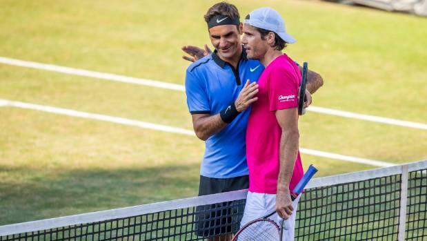 Roger Federer congratulates Tommy Haas at the Stuttgart Open.