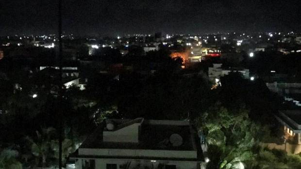 An explosion is seen at the Pizza House restaurant in Mogadishu.