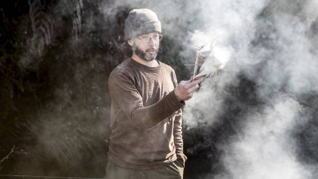 Deep Green Bush School co-founder and teacher Joey Moncarz shows students how to light a fire for lunch.