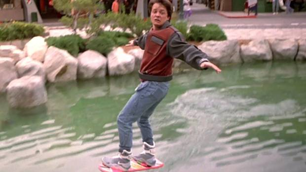 Michael J Fox, as Marty McFly, rides a hoverboard in Back to the Future 2.