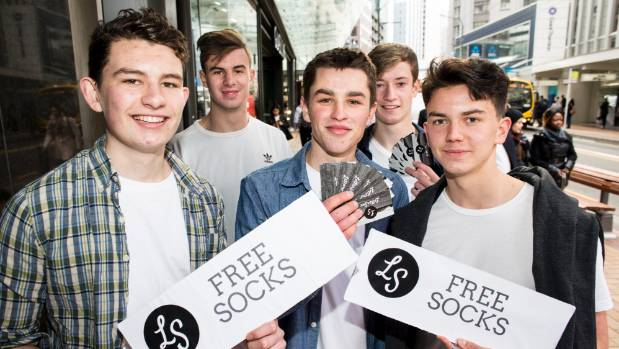 "The LetterSox team officially launched their company on Lambton Quay this week with 250 ""free socks"" cards. From left, ..."