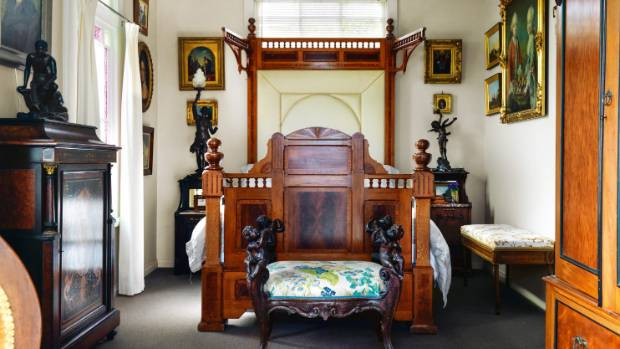 The ground floor master bedroom is furnished with New Zealand colonial furniture, with elaborate turned finials and ...