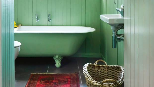 The clawfoot bath was a Trade Me find and the dado rail was crafted from original kauri tongue-and-groove wall linings ...