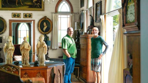 Steve Galpin, left, and Tor Muriwai by the French doors into the garden; the grandfather clock is Welsh.