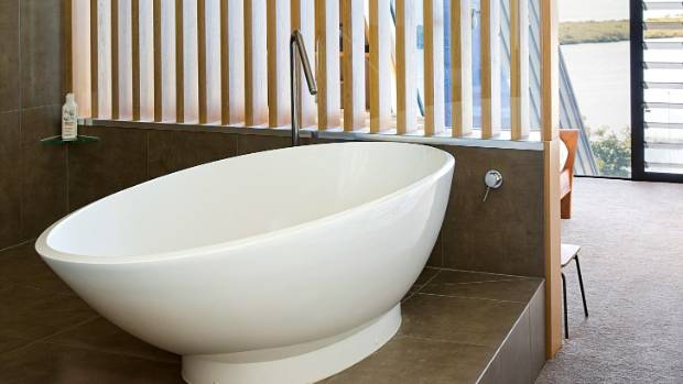 "The free-standing bath in the master en suite enjoys a view of the water while the timber screen ensures privacy: ""If ..."