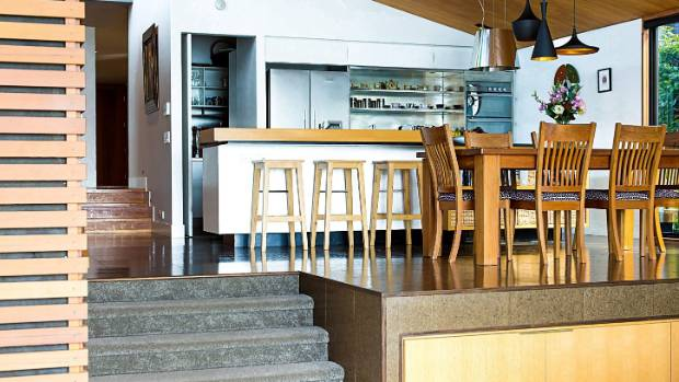 Plenty of warm timber was always part of the plan; the kauri dining table is nearly 20 years old and has a cluster of ...