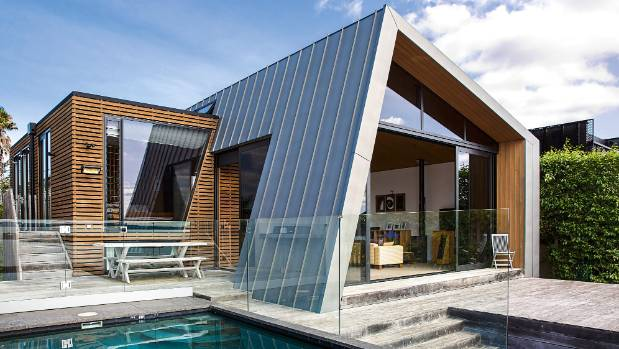 From the exterior, the bedroom block is defined by cedar battening, and zinc cladding wraps around the living zone.