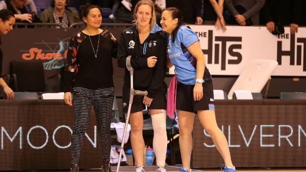 Wendy Frew of the Steel shows her injured leg after a team van crash. She and goal attack Te Paea Selby-Rickit remain ...