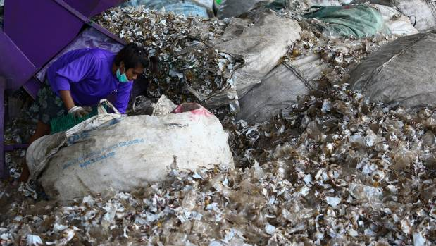 A worker sorts recyclable plastic waste at the Prabkaya Recycle Factory in Pathum Thani outside Bangkok, Thailand.
