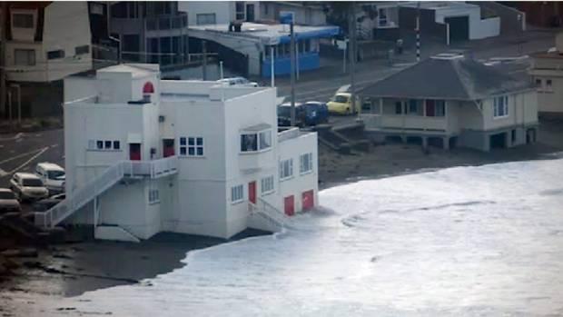 Swells surge up to the Maranui Surf Lifesaving Club at Lyall Bay, in May 2015.