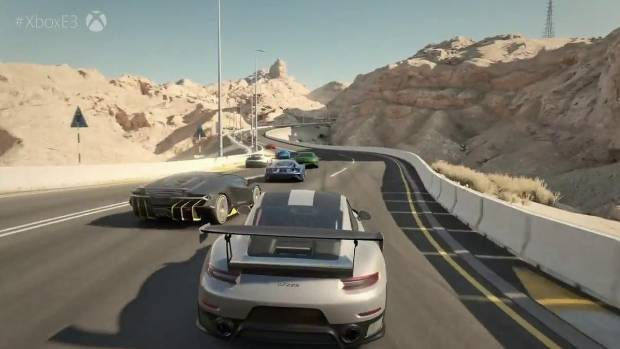 The Porsche 911 GTR2 hits the searing hot desert track of the Dubai Raceway.