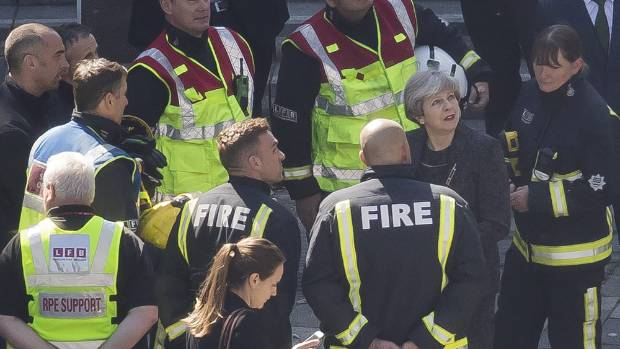 British Prime Minster Theresa May visits the scene of the Grenfell Tower blaze.
