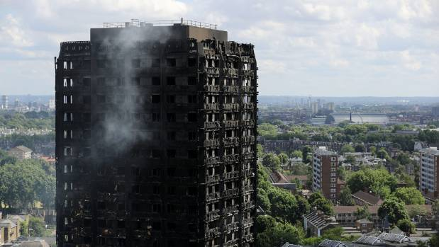 Smoke continues to rise from the Grenfell Tower apartment building in west London, two days after an inferno killed at ...