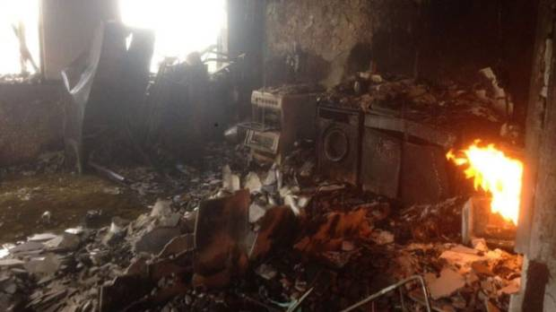 One of the first images from inside Grenfell Tower, showing the fires still burning more than a day after the fire.