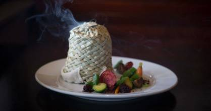 When it is presented at the table, the dish is covered with a flax basket that's had apple smoke fired into it.