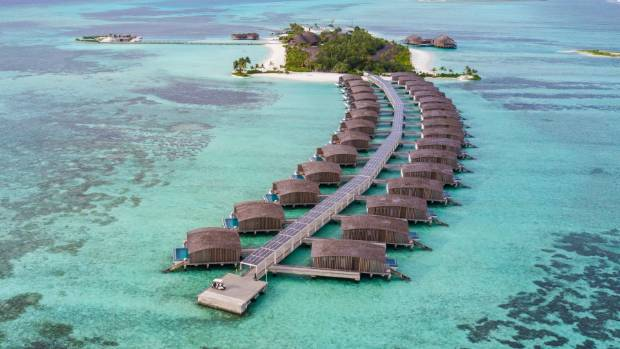 The walkway to the overwater villa is covered in solar panels, which power the entire resort.