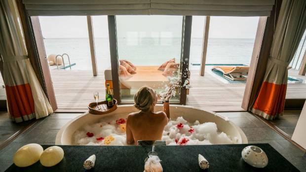 The bath overlooks the ocean.