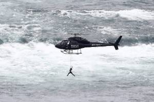 Wallenda had to signal to her helicopter pilot to get even higher and away from the wind.