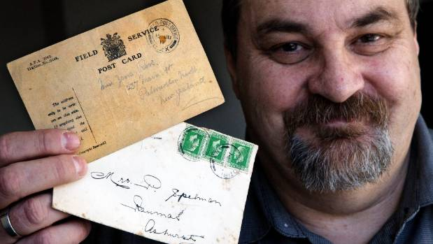Bruce Graves local philatelist holds two unusual letters, a Field Service postcard posted June 15, 1917 and a letter ...