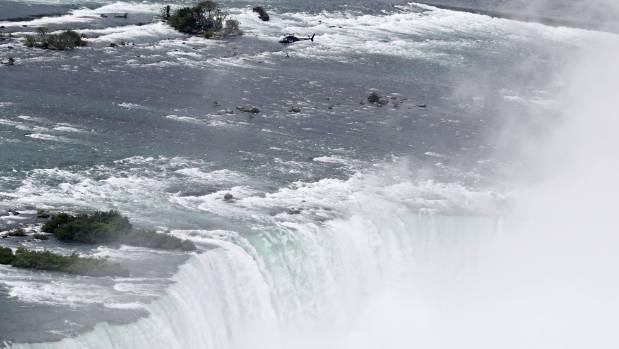 Wallenda suspended herself 91 metres above the water - using her teeth.